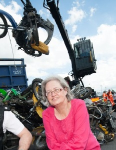 Cllr Sue Derbyshire oversees crushing of 30 illegal bikes